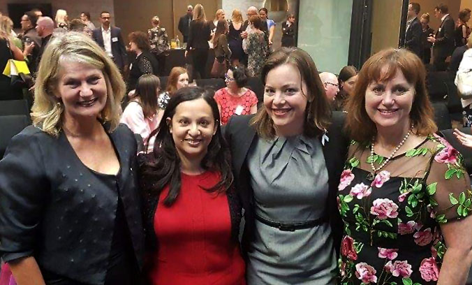 An image of Minister Genter at the YWCA Awards with Sarah Trotman, Gail Pacheco and Susan Doughty.